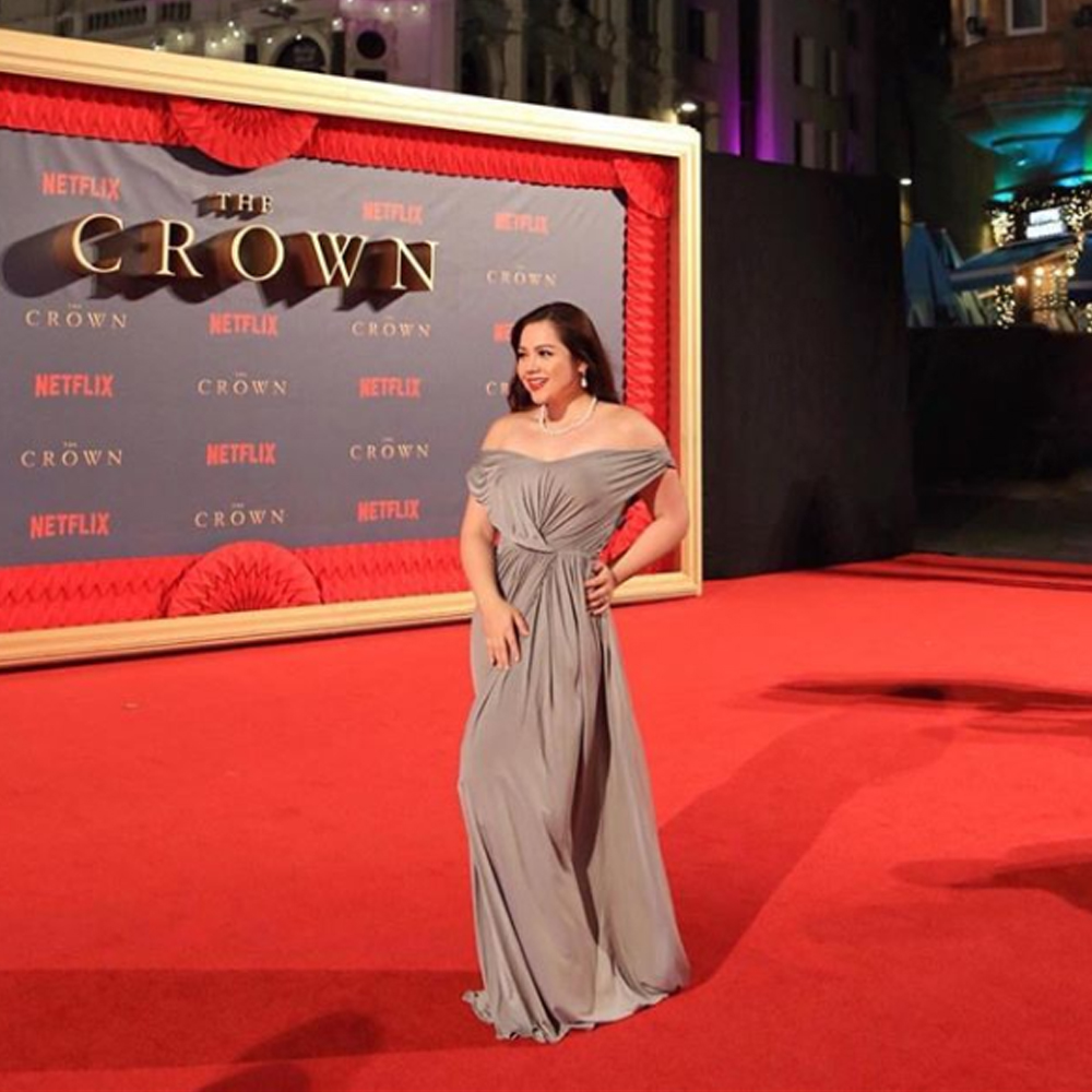 MJ Marfori in our Sienna Dress as she walks the red carpet of the world premier of netflix's the crown in London