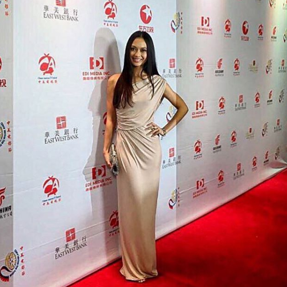 Singaporean actress Desiree Siahaan walks on the red carpet of the Chinese American Film Festival wearing our Pfeiffer Dress in Nude from our best sellers collection